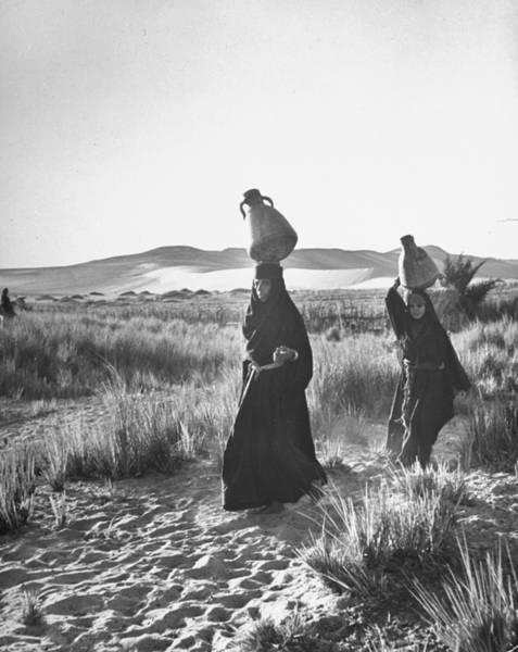 Jar Photograph - Bedouin Women Carrying Jars On Their Hea by Eliot Elisofon