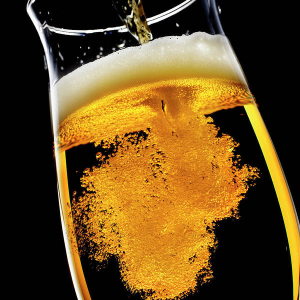 Alcohol Photograph - Beer Been Poured Into Glass, Studio Shot by Ultra.f