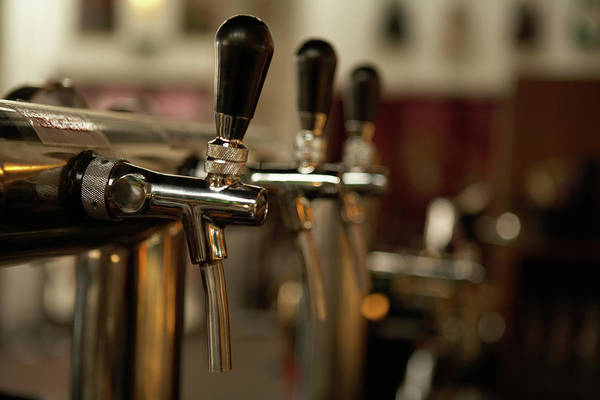 Bar Counter Photograph - Beer Taps At A Bar by Blue Jean Images