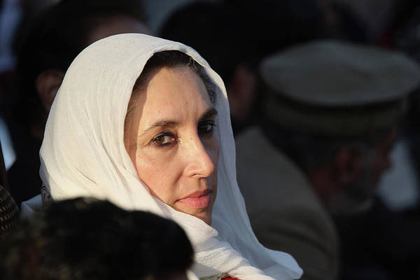 Photograph - Benazir Bhutto Killed In Suicide Attack by John Moore
