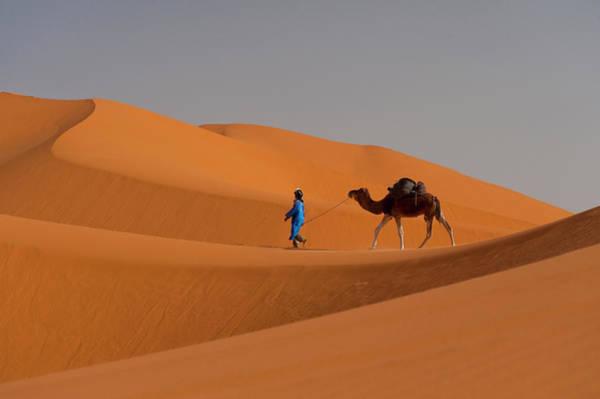 Berber Wall Art - Photograph - Berber Walking Across Sand Dunes In The by Ian Cumming