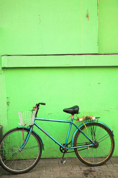 Wall Art - Photograph - Bicycle Outside Cafe, Jingwei Jie by Walter Bibikow