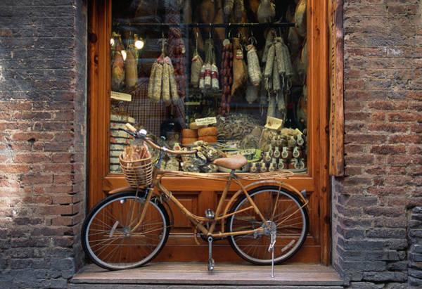 Delicatessen Photograph - Bicycle Outside Delicatessen by Grant Faint