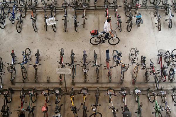 Bicycle Rack Photograph - Bicycle Park At Boon Lay Mrt Station by Kokkai Ng