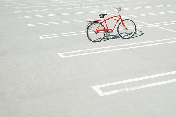 Out Of Context Photograph - Bike In Empty Parking Lot by Peter Starman