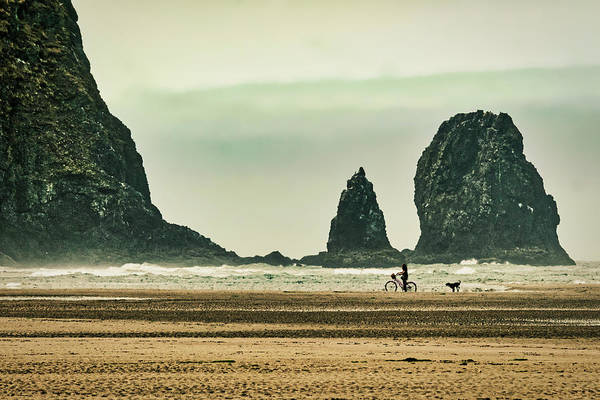 Photograph - Bike Rider And Dog On Cannon Beach - Oregon by Stuart Litoff