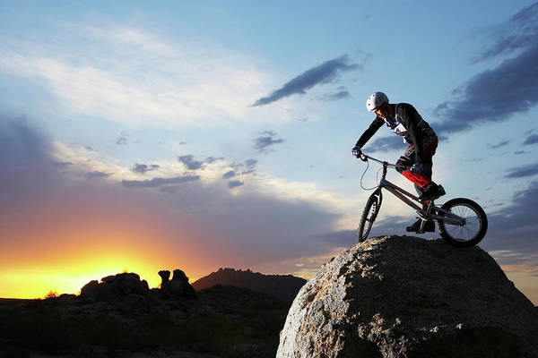 Extreme Sport Photograph - Bike Rider Balancing On Rock Boulder by Thomas Northcut