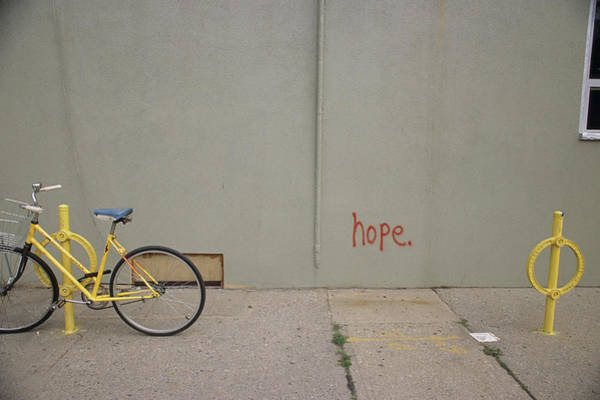 Bicycle Rack Photograph - Bike Sitting In Front Of Graffiti by Alan Sirulnikoff