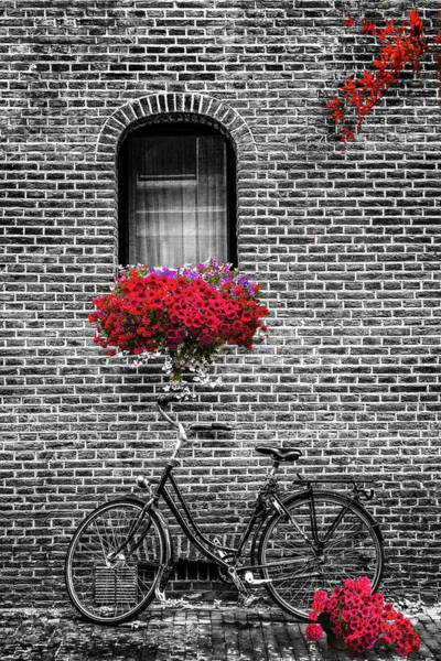 Photograph - Bike Under The Window In Black And White With Red Color Selected by Debra and Dave Vanderlaan