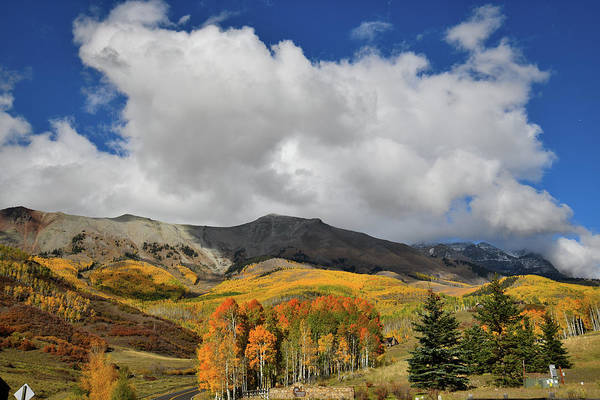 Photograph - Billowing Clouds Over Mountain Village Fall Colors by Ray Mathis