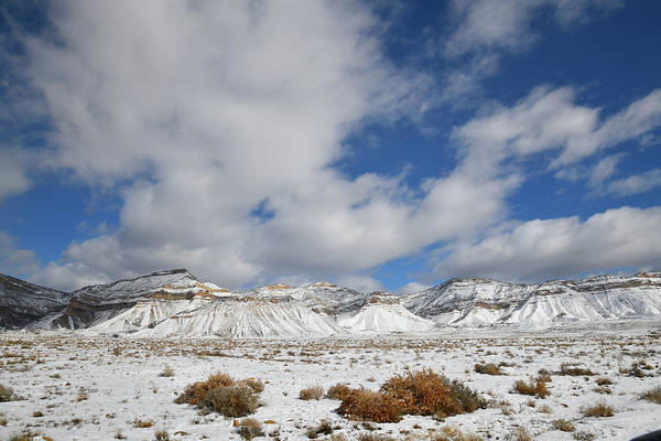 Photograph - Billowing Clouds Over Snow Covered Book Cliffs by Ray Mathis