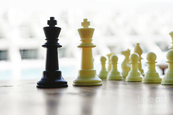 Photograph - Black And White Chess Kings Faced Between Defocused Pieces On Wooden Board. by Joaquin Corbalan