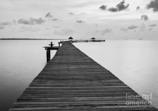 Red Bridge Wall Art - Photograph - Black And White Of Bridge On Beach In by Wassana Mathipikhai