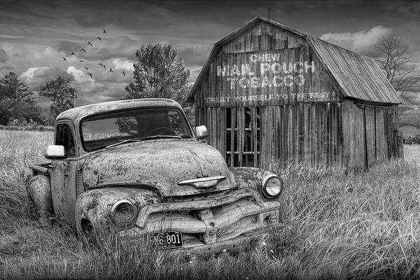 Photograph - Black And White Of Rusted Chevy Pickup Truck In A Rural Landscape By A Mail Pouch Tobacco Barn by Randall Nyhof