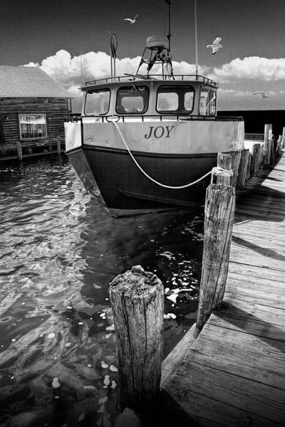 Photograph - Black And White Photograph Of The Boat Joy At Fishtown In Leland by Randall Nyhof