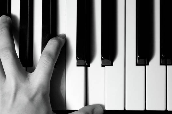 Human Hand Photograph - Black And White Piano by Daniel Candal