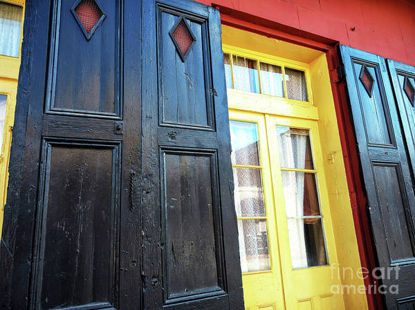 Photograph - Black And Yellow In New Orleans by John Rizzuto