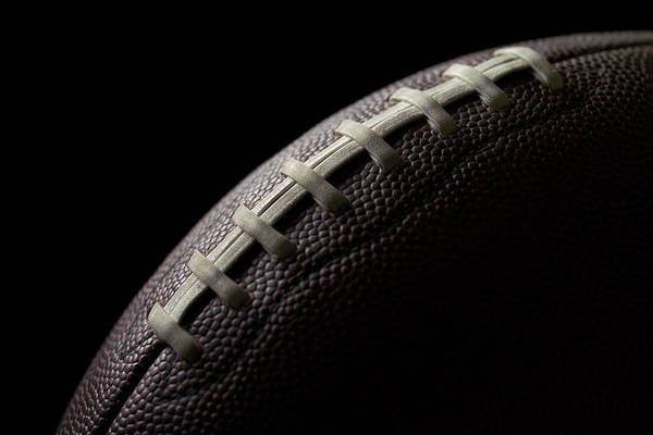 American Football Photograph - Black Football On A Black Background by Gregchristman
