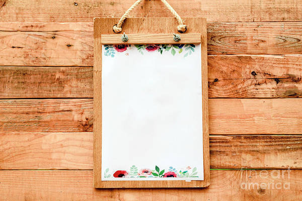 Photograph - Blank Paper On A Clipboard To Take Notice To Announce News On A Romantic Vintage Style Wooden Board. by Joaquin Corbalan