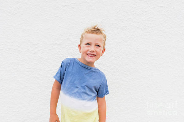 Photograph - Blond Boy Making Funny Faces On White Background. by Joaquin Corbalan