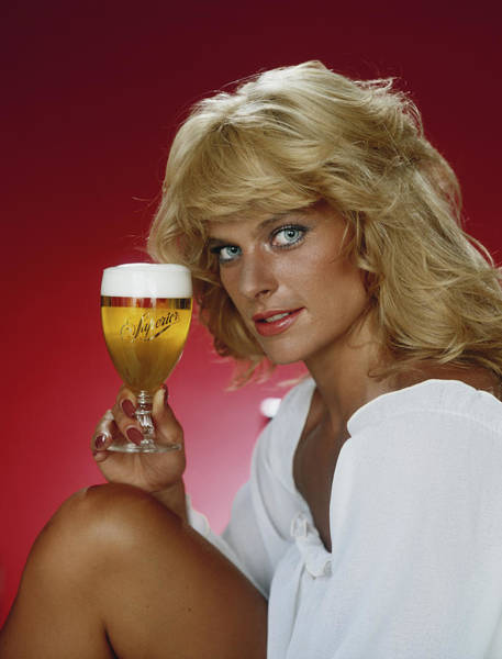1981 Photograph - Blonde Woman Holding Glass Of Beer by Tom Kelley Archive