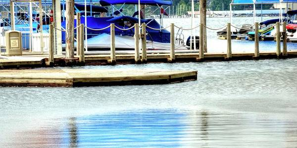 Photograph - Blue Awning Reflected In Smooth, Calm Water. by Jerry Sodorff
