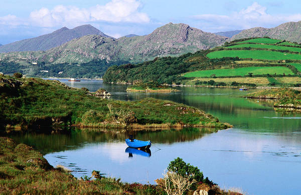 Emotion Photograph - Blue Boat On Tranquil Kenmare River by John Banagan
