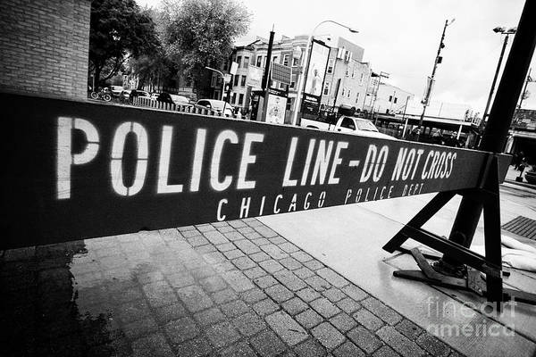 Wall Art - Photograph - blue police line do not cross wooden chicago police department barrier Chicago IL USA by Joe Fox