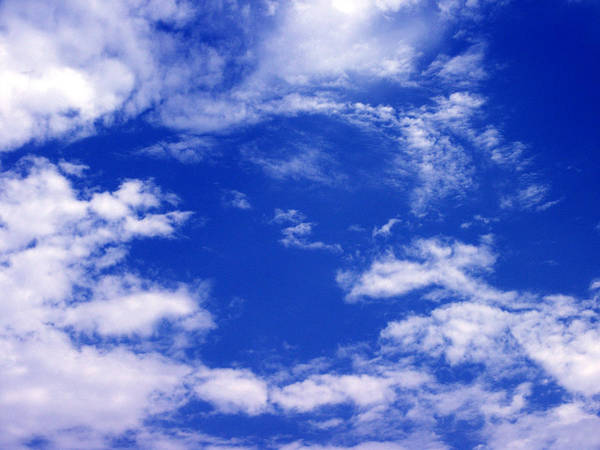 Wall Art - Photograph - Bluest Clouds by Elerium
