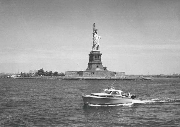 Statue Photograph - Boat Floating By Statue Of Liberty, New by George Marks