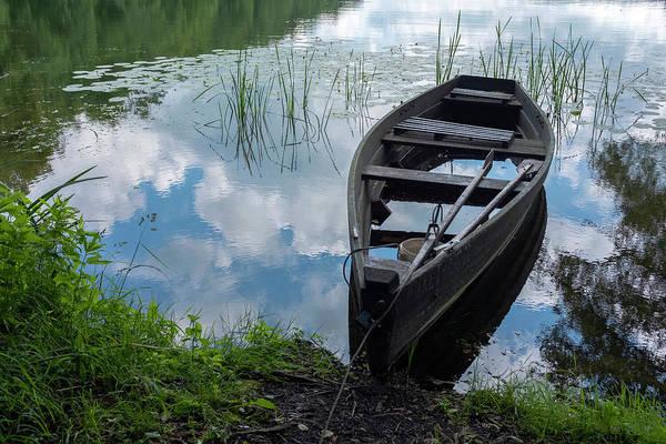 Photograph - Boat In A Lake Near Sweita Lipka, Northern Poland by Dubi Roman