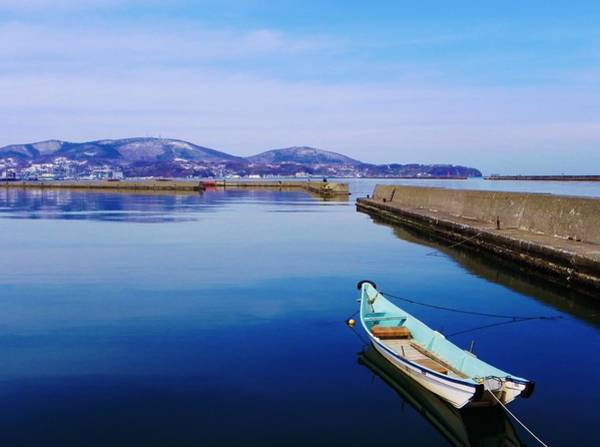 Stationary Photograph - Boat In Blue Harbour At Otaru Chikko In by Anne Mckechnie