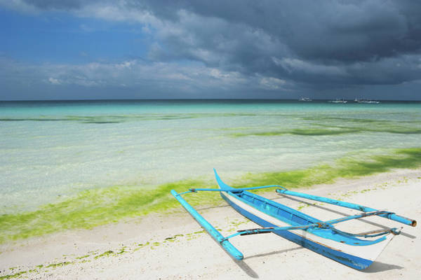 Philippines Photograph - Boat On White Sand Storm Clouds Above by Laurie Noble