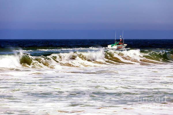 Photograph - Boat Past The Waves At Zuma Beach by John Rizzuto