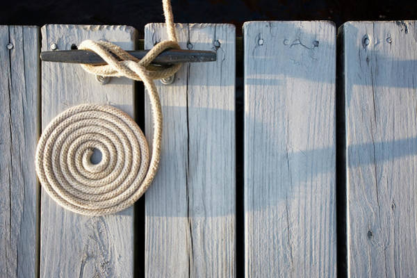 June Lake Photograph - Boat Rope Coiled On Dock by Nine Ok