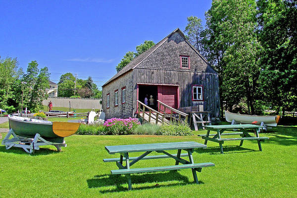 Wall Art - Photograph - Boats And Boathouse At St. Laurent Maritime Park On Ile D'orleans, Quebec by Ruth Hager