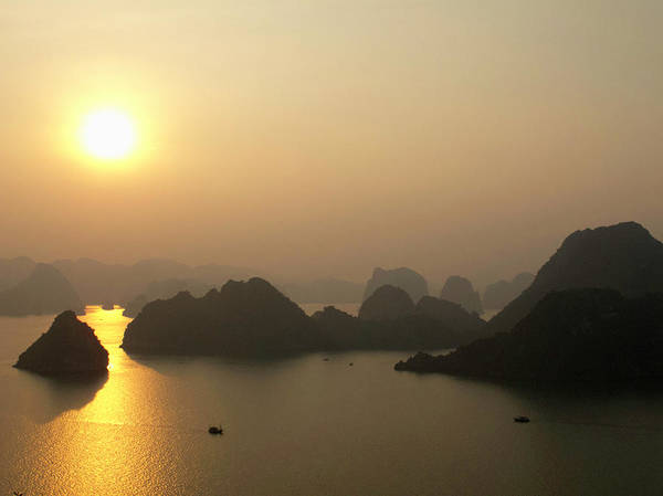 Photograph - Boats Cruise Through Ha Long Bay At by Ryan Green