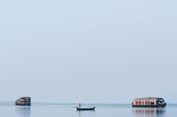 Kerala Photograph - Boats In A Lagoon, Kerala Backwaters by Exotica.im