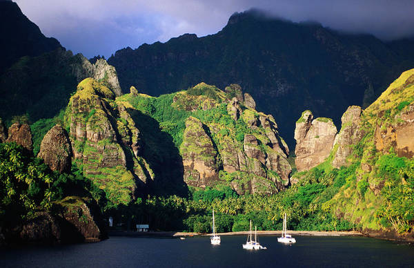 Fatu Hiva Wall Art - Photograph - Boats Moored At The Bay Of Virgins by Peter Hendrie