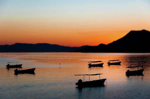 Wall Art - Photograph - Boats On Lake Chapala At Sunset by Dane Strom
