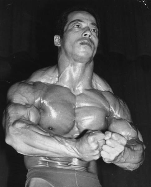 1976 Photograph - Body Builder by David Ashdown