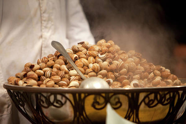 Boil Photograph - Boiled Snails On A Market Stall In by Huw Jones