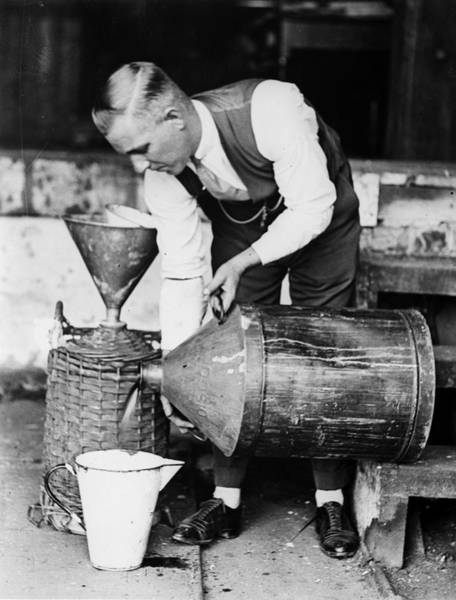 Pouring Photograph - Bootlegging by Fox Photos
