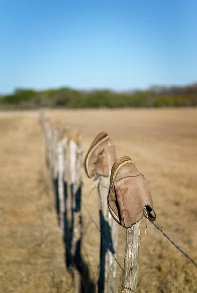 Upside Down Photograph - Boots On Fence by Austinartist