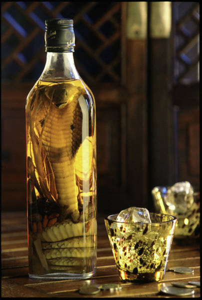 Delicatessen Photograph - Bottle Of Spirits With Pickled Cobra by Per-andre Hoffmann / Look-foto