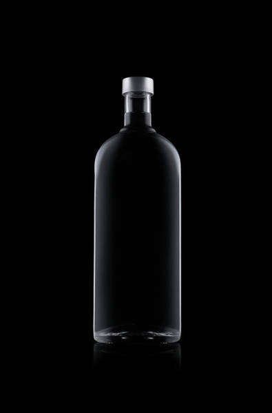 Drinking Glass Photograph - Bottle Of Water Isolated On Black by Kedsanee