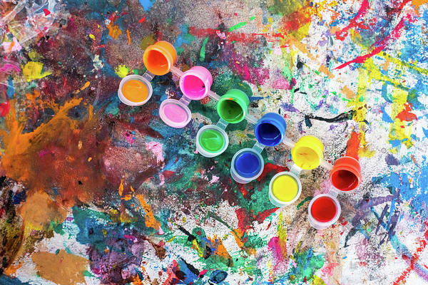 Photograph - Bottles Of Paint Of Various Colors To Decorate Plaster Objects. by Joaquin Corbalan