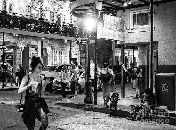 Photograph - Bourbon Street Happenings At Night New Orleans by John Rizzuto