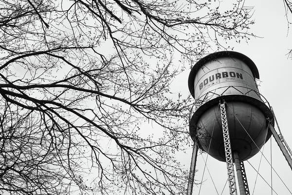 Photograph - Bourbon Vintage Water Tower And Tree Branches - Black And White by Gregory Ballos