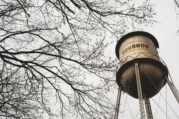 Photograph - Bourbon Vintage Water Tower And Tree Branches - Sepia by Gregory Ballos